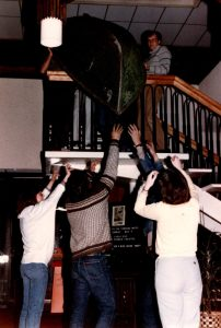 """Carrying the boat for """"Talley's Folly"""" up the stairs at the Best Western."""