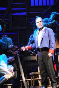 Derrick Cunningham, middle, as Jean Valjean in Les Miserables