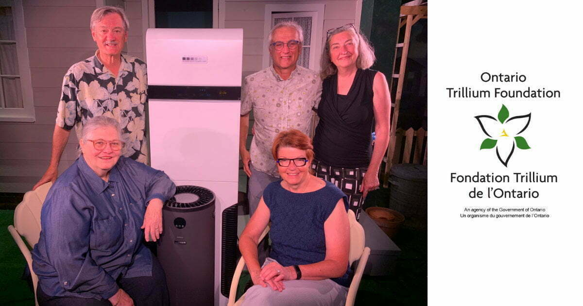 A photo of the team responsible for submitting the Ontario Trillium Foundation grant application with one of the air scrubbers purchased with the grant money.